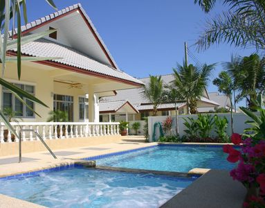 Pool villa wheelchair accessible with pool hoist and bannister.