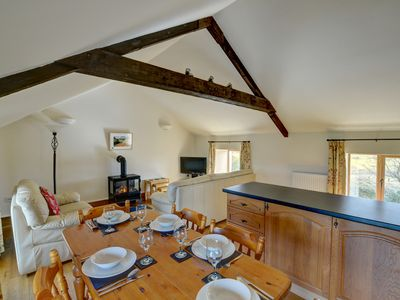 Photo for An attractive white-painted cottage, attached to the owners' home, in beautiful unspoilt countryside