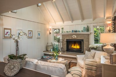 ~  - Living room with wood-burning fireplace and gas kindler.