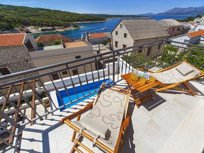 Photo for This 5-bedroom villa for up to 10 guests is located in Povlja and has a private swimming pool, air-c