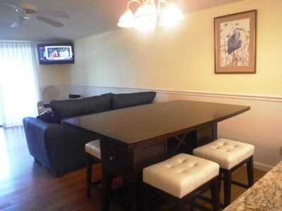 Brand new counter height table with seating for up to six.