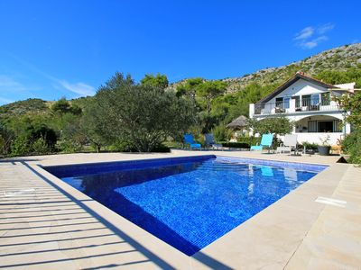 Photo for THE CAPTAIN`S HOUSE 6 km from sandy beach with heated pool and sea views