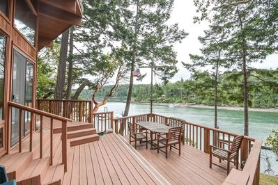Welcome to Neil Bay!  This beautiful property is nestled on a low hill right above the water.  Wow.  Get ready, your vacation starts now.