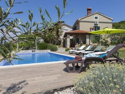 Photo for Traditional Istrian house with a nice garden, pool and sea view