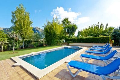 Deck chairs on the pool and garden terrace