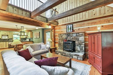 You'll love the open layout and exposed beam ceilings of the main living space!