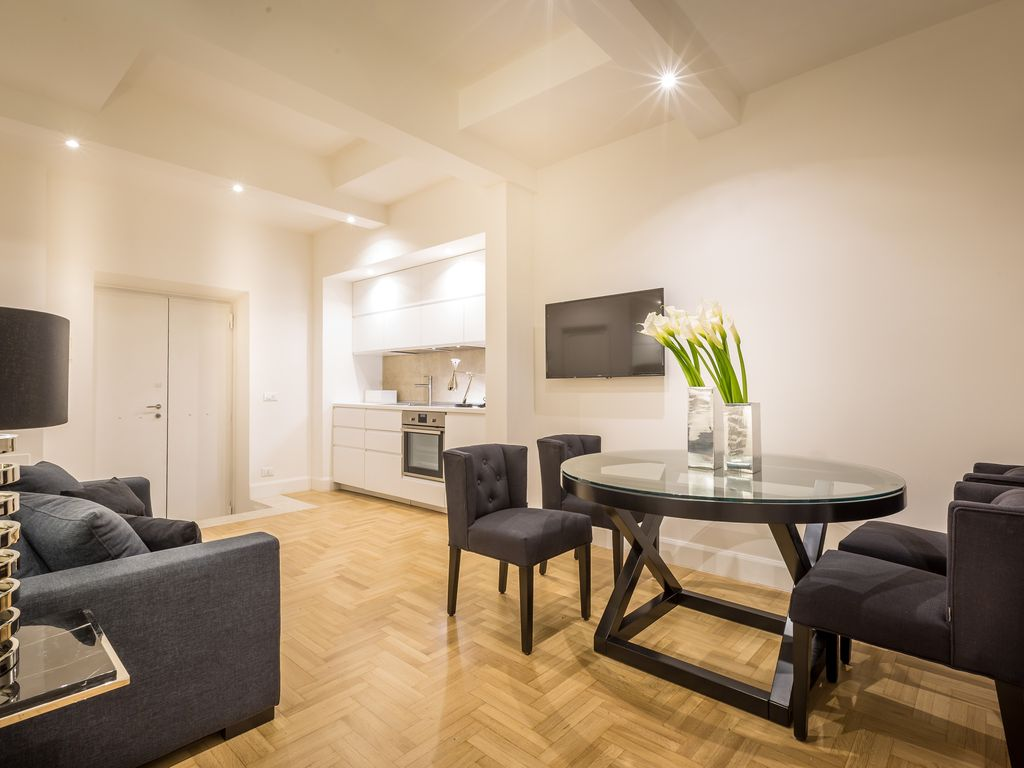 Centro Storico Apartment Rental   The Living Room With A Sofa Bed And The  Modern Kitchenette
