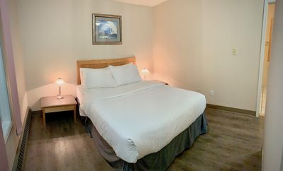 Room 27 features on queen bed, with separate sitting area, pull out couch and full private bath