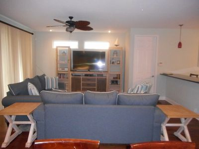 """Living area, new furniture, new 65"""" TV"""