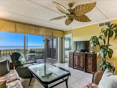 Photo for This 1st floor 2 bedroom 2 bath unit has been completely renovated, wonderfully decorated in bright, gorgeous colors and also offers a panaramic view of the ocean from the comfortable, private patio.