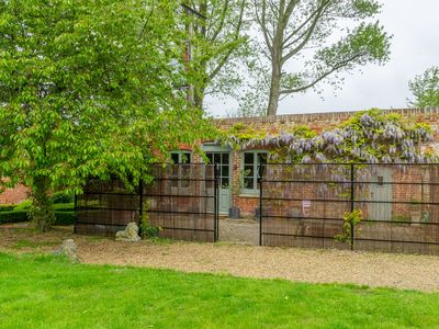 Photo for This gorgeous retreat is tucked into the walled garden on the Fring Estate.