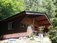 Secluded Cabin in woodland area close to river.