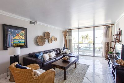 Spacious Living Room. Big windows allow  lots of natural light. Condo faces East