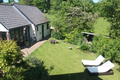 The Studio Apartment and the garden by the stream with sunloungers just in case!