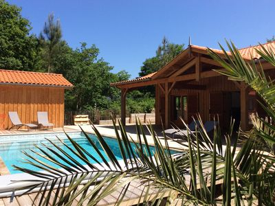 Photo for Golf Biscarrosse classified wood villa 4 * Heated pool and lake nearby