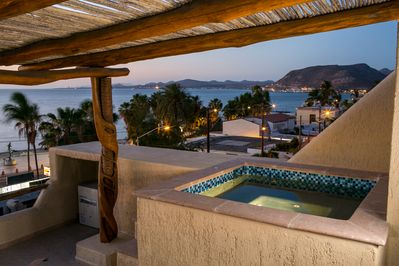 What better place to watch a sunset than a rooftop hot tub?