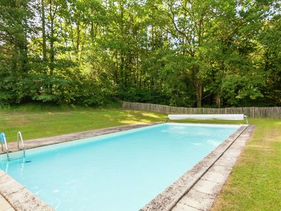 Photo for Impressive, restored farmhouse with private pool, surrounded by woods.
