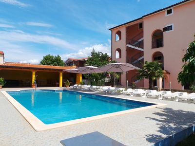 Photo for Holiday apartment with pool and balcony