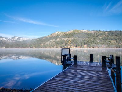 Photo for Stunning, dog-friendly lakefront home with a dock - mountain & lake views!