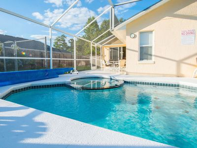 Photo for Florida Villa Lake Side View with 36ft South facing Pool & Spa