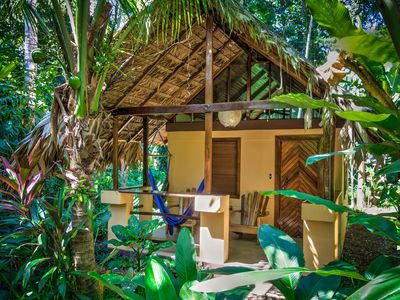 Photo for Paradise - Pool, beach, private jungle bungalow @ Caribe Town Hotel