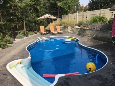 Photo for Serene Pool Paradise Minutes To Major Attractions