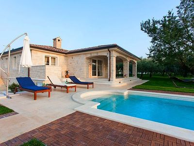 Photo for Elegant new stone villa with large pool