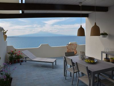 Photo for THE HOUSE IN BLUE - high above the sea with breathtaking views of Mount Etna