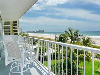 Photo for Beachfront condo w/ heated pool, tennis courts & panoramic ocean view