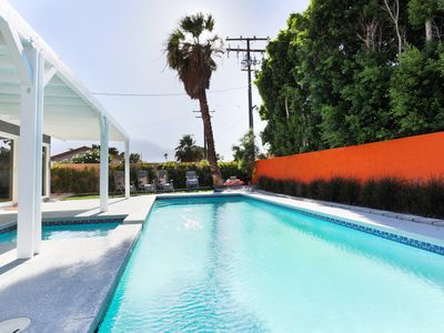 Photo for Chill out in massive, private back yard with a huge pool, spa & 40' patio cover