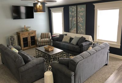 Large living room with three sofa sleepers