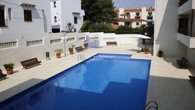 Photo for AT007 MARTINETA: Apartment with pool, parking and wifi at 150m from the beach