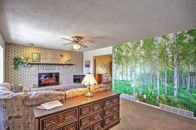 This large mural gives the room a bright, airy feel.