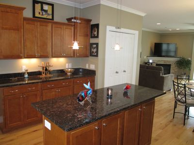 Kitchen flowing into Dining and Living area