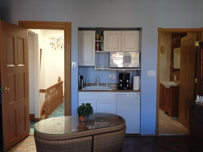 Studio kitchenette with view into hall and bath