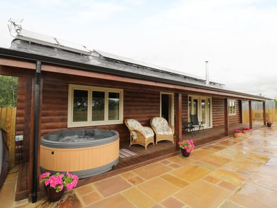 Photo for THE LODGE, pet friendly, with hot tub in Bampton, Ref 961444