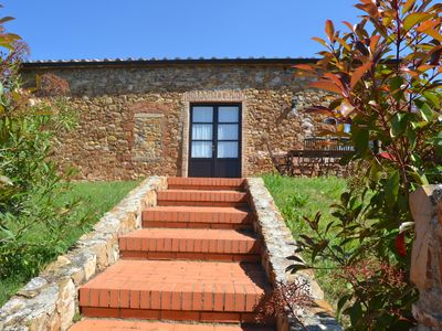 Photo for Charming stone village with swimming pool, tennis, in the countryside near the sea and services