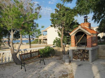 Photo for Two bedroom apartment with terrace and sea view Kustići (Pag)