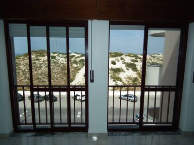 Photo for nice apartment right on the endless surf beach of Peniche
