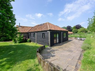 Photo for A stylish single storey barn conversion in a pretty and rural location