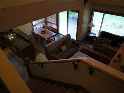 Living area from upstairs, hot tub outside