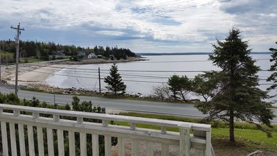 Photo for Newly listed newly renovated home, 50 meters from sandy beach. Beautiful views.