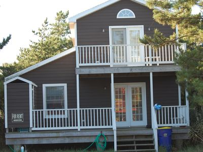 Photo for A Block from the Beach!  Large screened in porch with dining and seating area.