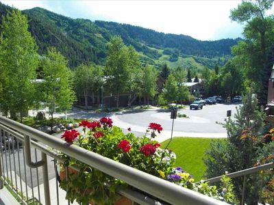 View of Aspen Mountain from Balcony with dining table & private deluxe gas BBQ.