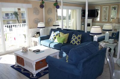 Seating Area- Overlooking the pool-New furniture-Oversize chair is a pull bed.