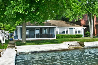 Back of the house with lake front view, private access to the beach and dock
