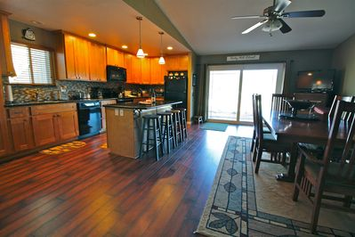 Spacious kitchen and dining area with TV and beautiful view!