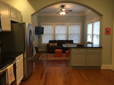 Renovated kitchen opens to sunroom
