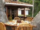 Enjoy dining on the large tree house deck (detached bodega behind)