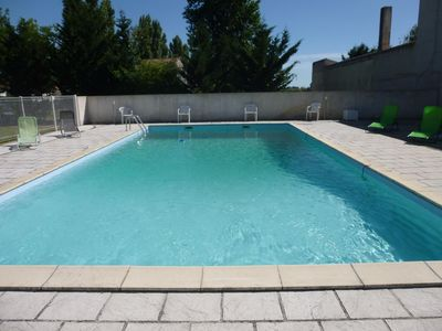 Photo for 2 Bedroom Gite in village. Large swimming pool and garden.  25mins to beach
